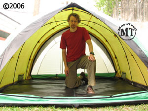 Bibler Pueblo 4 person ultralight mountaineering tent with model kneeling inside & Pueblo tent :: Moontrail