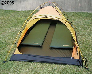 Hilleberg Jannu 2 person mountaineering tent; interior with model & Jannu red-colored fly :: Moontrail