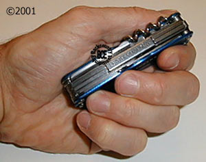 leatherman juice cs4 glacier - in hand; closed; side view